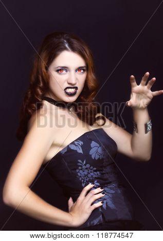 Evil Vampire Girl Portrait On Black Background