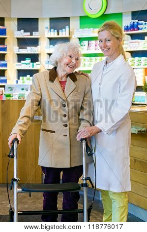 Satisfied Pharmacy Customer With Pharmacist