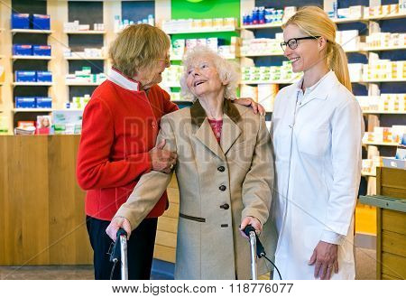 Friendly Doctor Talking With Two Elderly Women