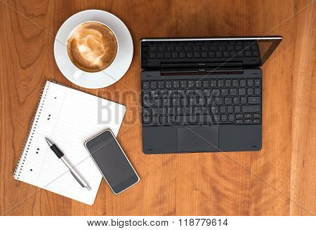 Notebook,smartphone, Notepad With Pen And  Cappuccino On Wooden Table