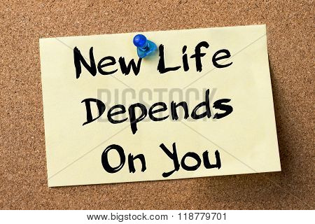 New Life Depends On You - Adhesive Label Pinned On Bulletin Board