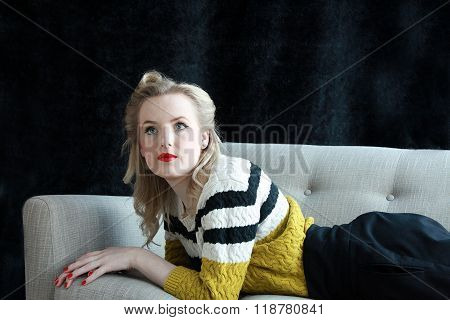 Beautiful 1940's Woman Lying On A Sofa