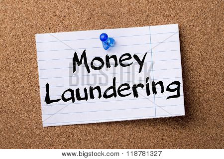 Money Laundering - Teared Note Paper Pinned On Bulletin Board