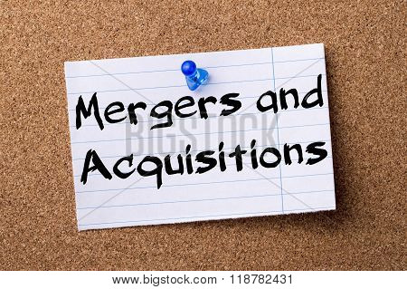 Mergers And Acquisitions - Teared Note Paper Pinned On Bulletin Board