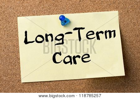 Long-term Care - Adhesive Label Pinned On Bulletin Board