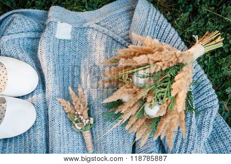 wedding bouquet and shoes, boutonniere, grass