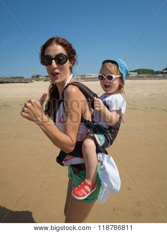Singing Thumb Up Mother And Baby In Backpack