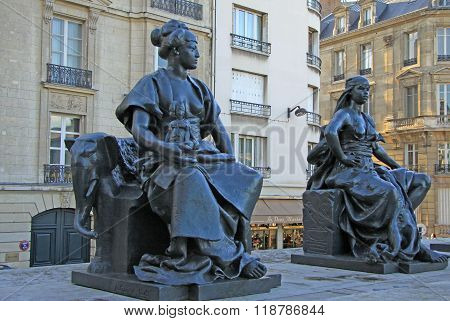 Paris, France -18 December 2011: Statues Of Six Continets In Front Of Orsay Museum