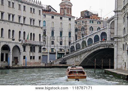 Venice, Italy - September 04, 2012: Motor Boat At Rialto Bridge On Grand Canal, Venice, Italy