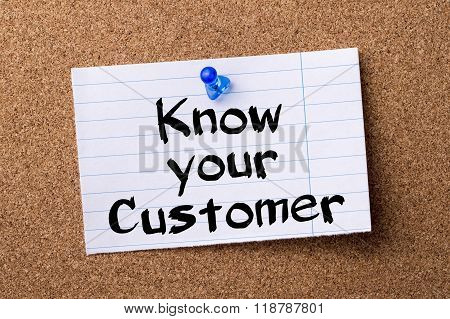 Know Your Customer - Teared Note Paper Pinned On Bulletin Board