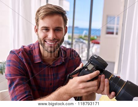 photographer holding camera and smiling