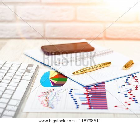 Workplace of businessman on a wooden work table, close-up