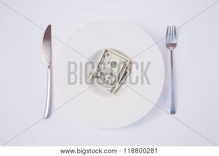 Dish With Dollar Banknotes