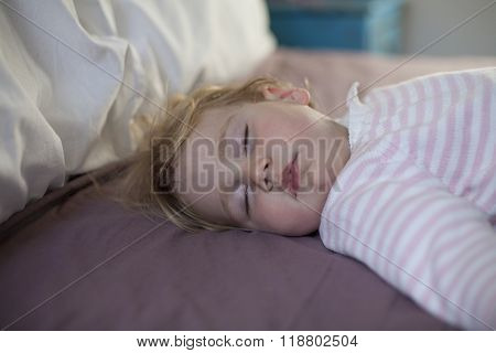 Face Of Baby Sleeping On King Bed