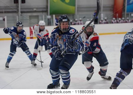 ST. PETERSBURG, RUSSIA - FEBRUARY 17, 2016: Alyona Polenska (center) of  women's ice hockey team Dinamo Saint-Petersburg in the match against Biryusa Krasnoyarsk. Dinamo won the match 3-1