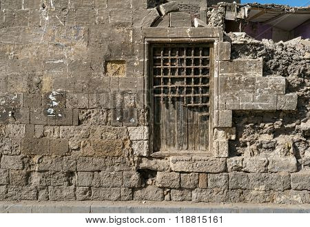 Old Abandoned Wall With Closed Ornate Wooden Window