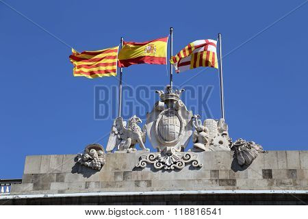Spanish and Catalan flags on the building of the City Council of Barcelona.