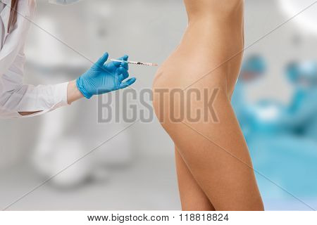 Botox Injection. Attractive Young Woman. Doctor In Medical Headwear And Sketches While Hand Making A