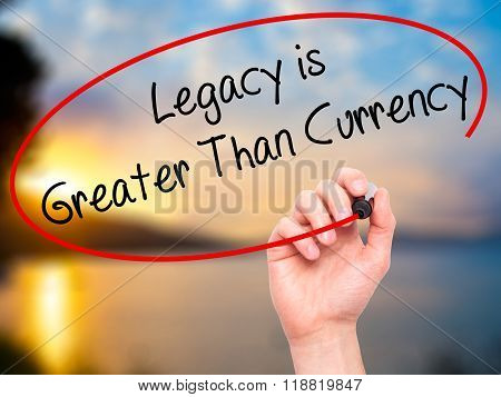 Man Hand Writing Legacy Is Greater Than Currency With Black Marker On Visual Screen