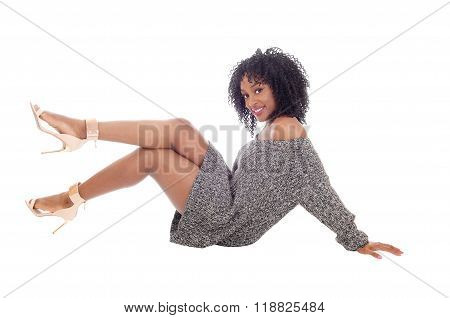 African American Woman Sitting On Floor.