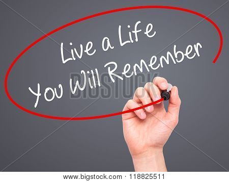 Man Hand Writing Live A Life You Will Remember With Black Marker On Visual Screen