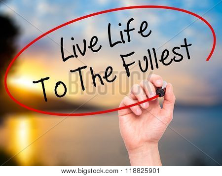 Man Hand Writing Live Life To The Fullest With Black Marker On Visual Screen