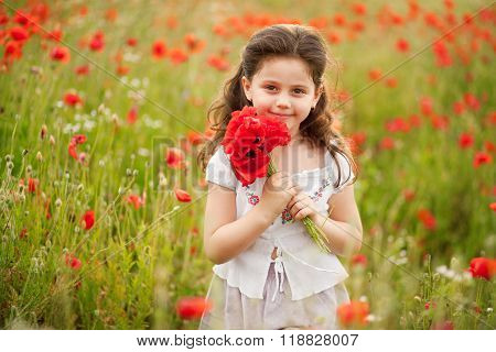 Happy kid with poppies.