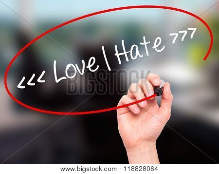 Man Hand Writing Love - Hate  With Black Marker On Visual Screen