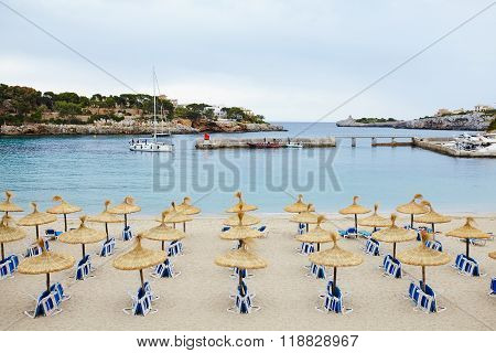 Group of umbrellas and sunloungers