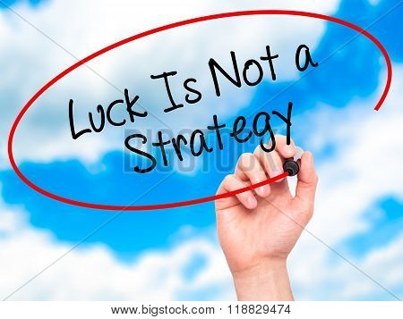 Man Hand Writing Luck Is Not A Strategy With Black Marker On Visual Screen