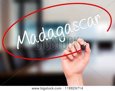 Man Hand Writing Madagascar With Black Marker On Visual Screen