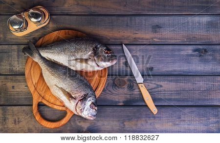 N A Wooden Table Cutting Board With Fresh Raw Dorado
