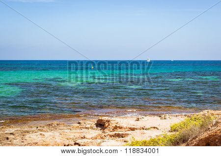 Sailboats Floating In Sea On Horizon, Av De La Purisima, Torrevieja, Spain