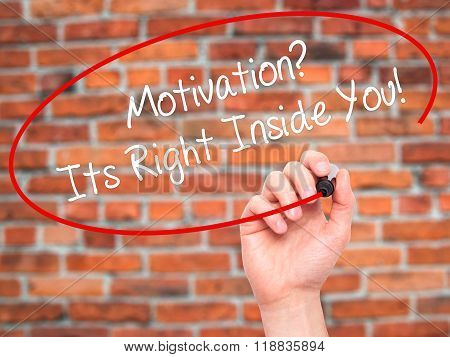 Man Hand Writing Motivation? Its Right Inside You!  With Black Marker On Visual Screen