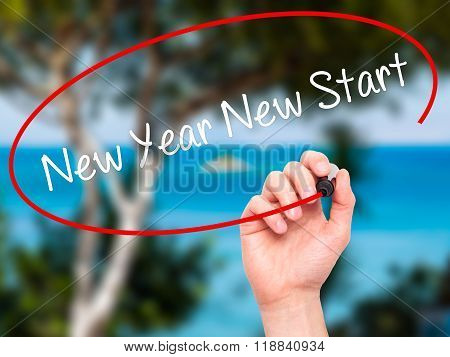 Man Hand Writing New Year New Start With Black Marker On Visual Screen