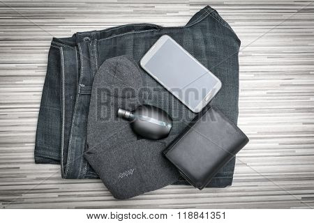 Set of modern young man - jeans, wallet, mobile phone, perfume, socks. still life