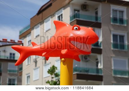 Funny Orange Shark With Snow-white Smile In The Sunshine