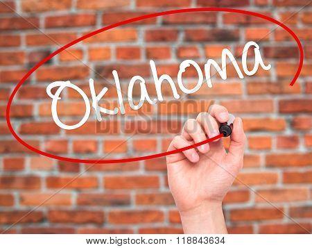 Man Hand Writing Oklahoma With Black Marker On Visual Screen