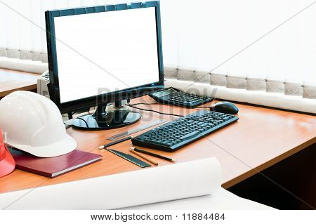 Working Place With Computer, Hard Hat And Project Drawings. White Isolated Screen