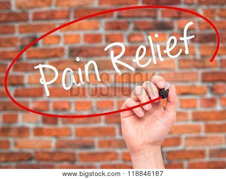 Man Hand Writing Pain Relief With Black Marker On Visual Screen
