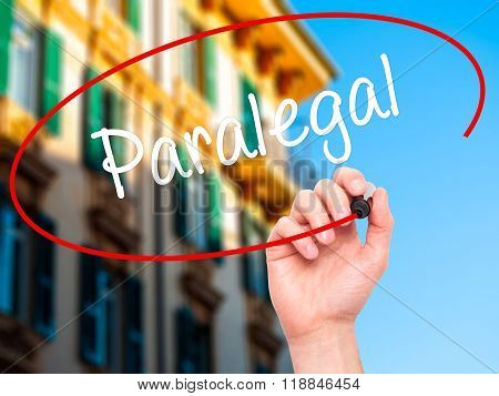 Man Hand Writing Paralegal With Black Marker On Visual Screen