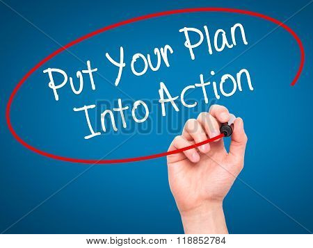 Man Hand Writing Put Your Plan Into Action With Black Marker On Visual Screen
