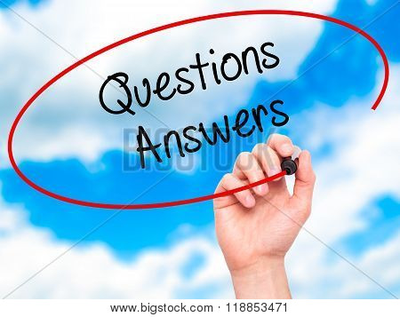Man Hand Writing Questions Answers With Black Marker On Visual Screen