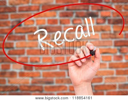 Man Hand Writing Recall  With Black Marker On Visual Screen
