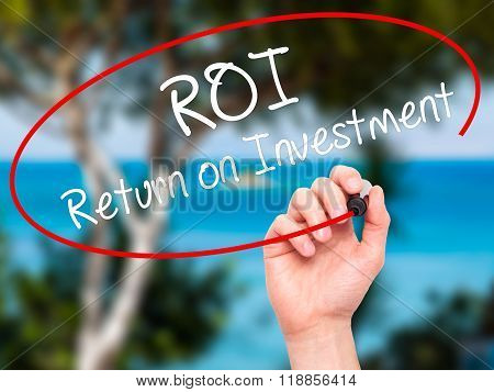 Man Hand Writing Roi  Return On Investment With Black Marker On Visual Screen