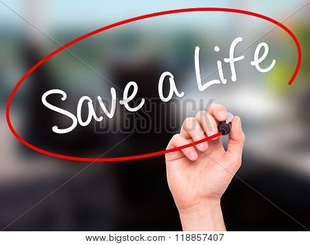 Man Hand Writing Save A Life  With Black Marker On Visual Screen