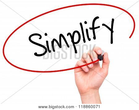 Man Hand Writing Simplify With Black Marker On Visual Screen