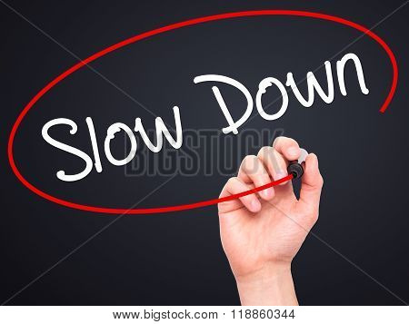 Man Hand Writing Slow Down With Black Marker On Visual Screen