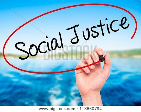 Man Hand Writing Social Justice With Black Marker On Visual Screen
