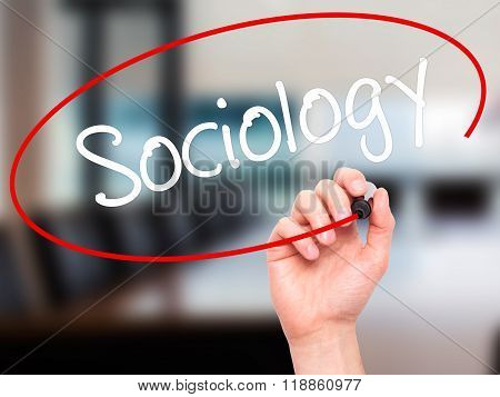 Man Hand Writing Sociology  With Black Marker On Visual Screen